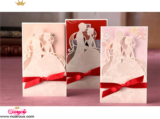 کارت عروسی دست ساز طرح عروس داماد صورتی